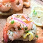 Pickled shrimp on a wooden cutting board
