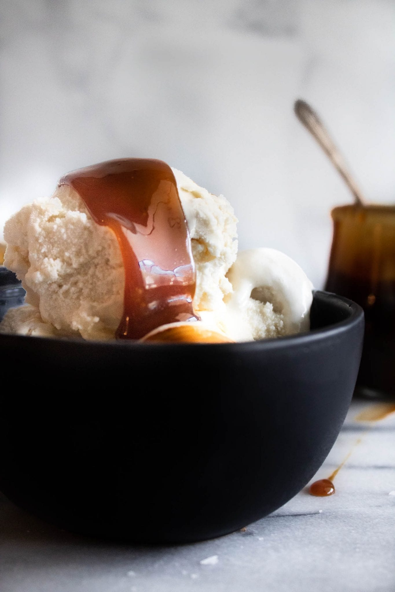 apple cider caramel in a black bowl with ice cream