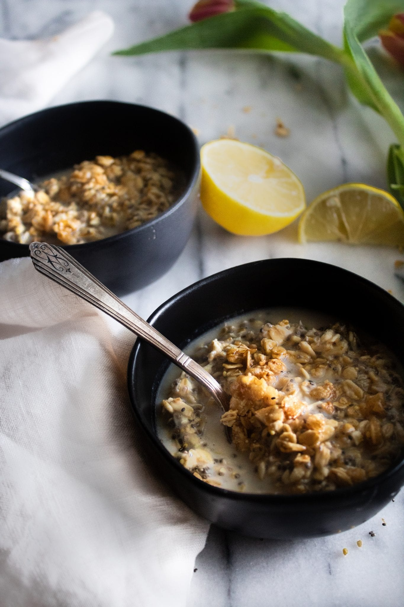 two bowls of oatmeal with lemon