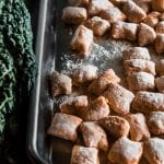 sweet potato gnocchi on a sheet pan with kale