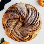 overhead shot of pumpkin brown sugar babka with mini pumpkins
