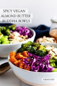 two vegan buddha bowls with spicy almond butter dressing with text overlay