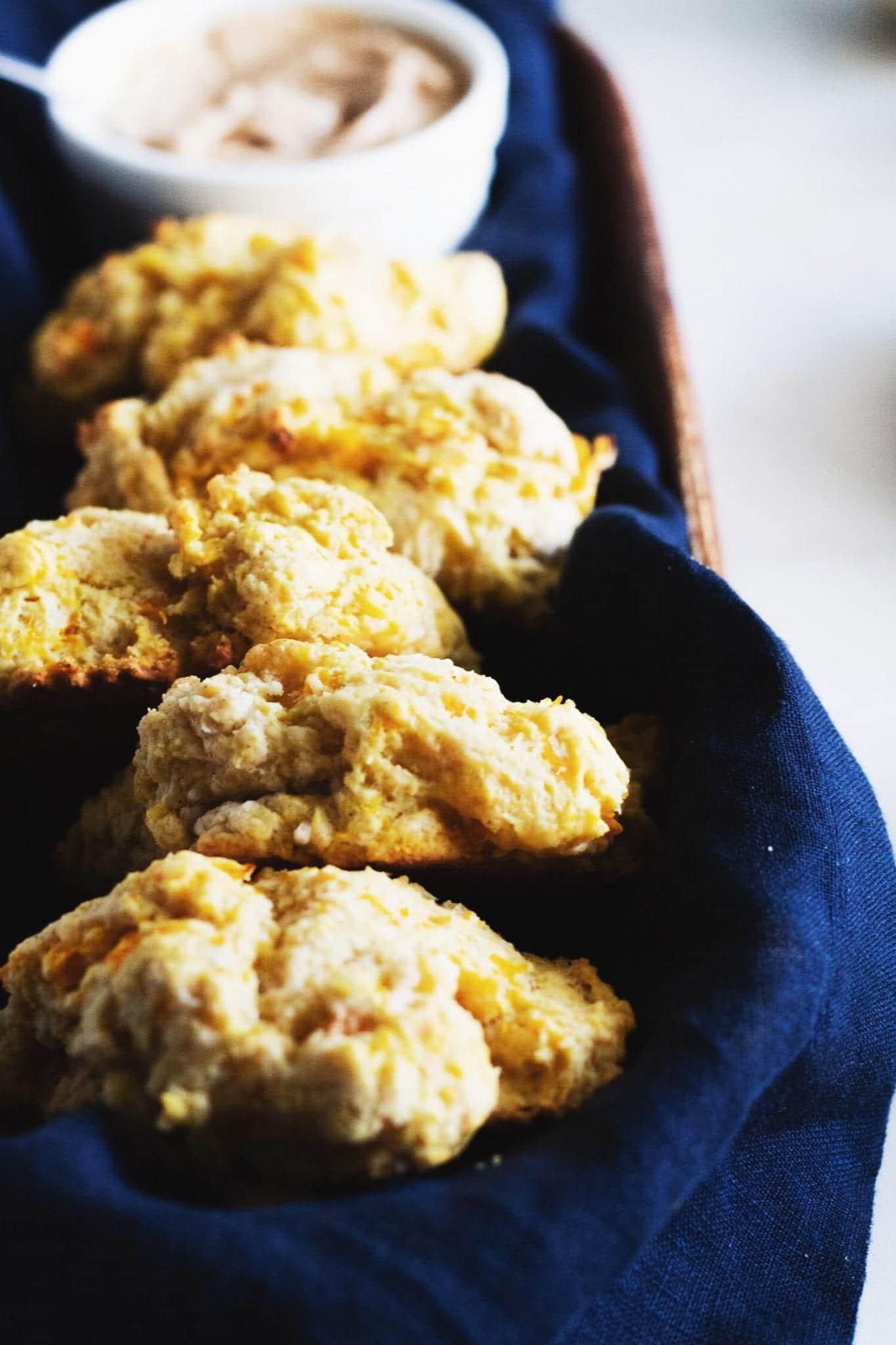 five butternut squash biscuits with maple cinnamon butter