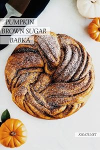 pumpkin brown sugar babka ring with white and orange pumpkins and text overlay