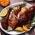 Carved orange and honey roasted turkey on a platter