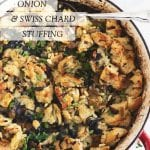 Caramelized onion and Swiss chard stuffing in a red pan with handles with a spoon and text overlay
