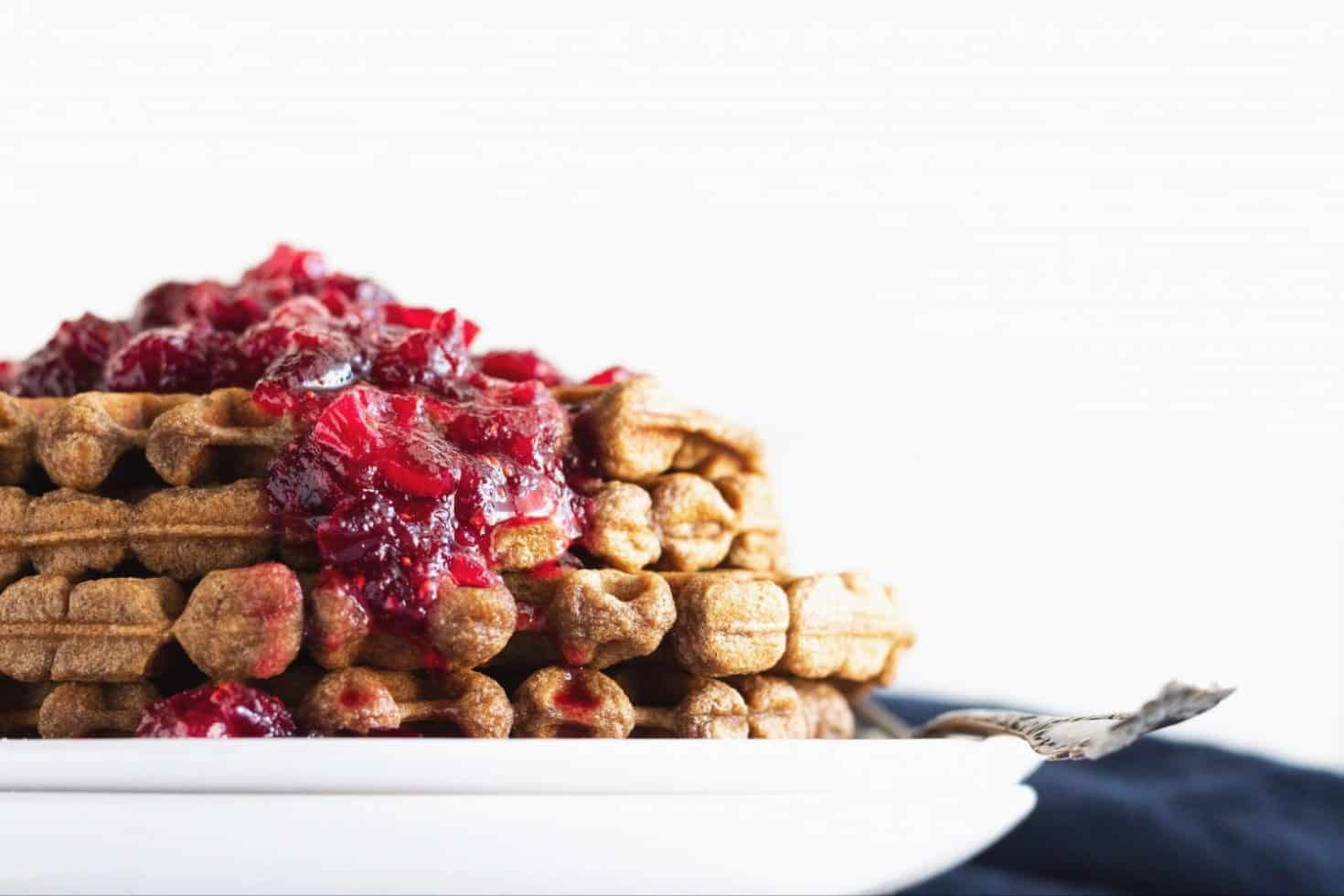 close up of gingerbread waffles with cranberry maple compote