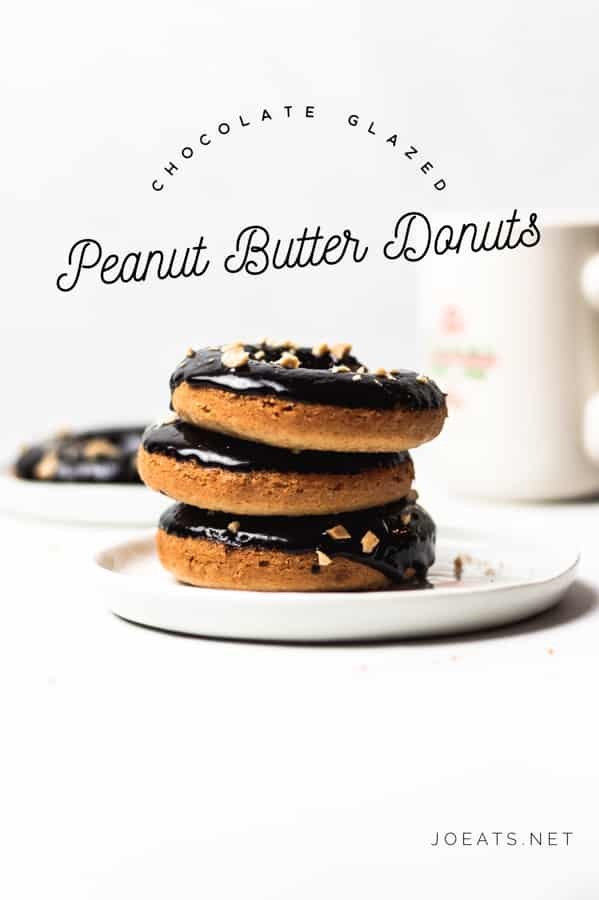 Sweet, tender, baked peanut butter donuts paired with a dark-as-night chocolate glaze will send you straight to donut heaven. Get the delicious and easy recipe at joeats.net! #joeats #donuts #bakeddonuts #baking #dessert #doughnuts