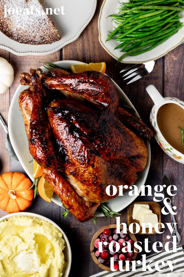This orange and honey roasted turkey is juicy, flavorful, and picture perfect. Get the surprisingly easy recipe for your holiday table at joeats.net #turkey #thanksgiving #holiday #thanksgivingtips #turkeytips #joeats