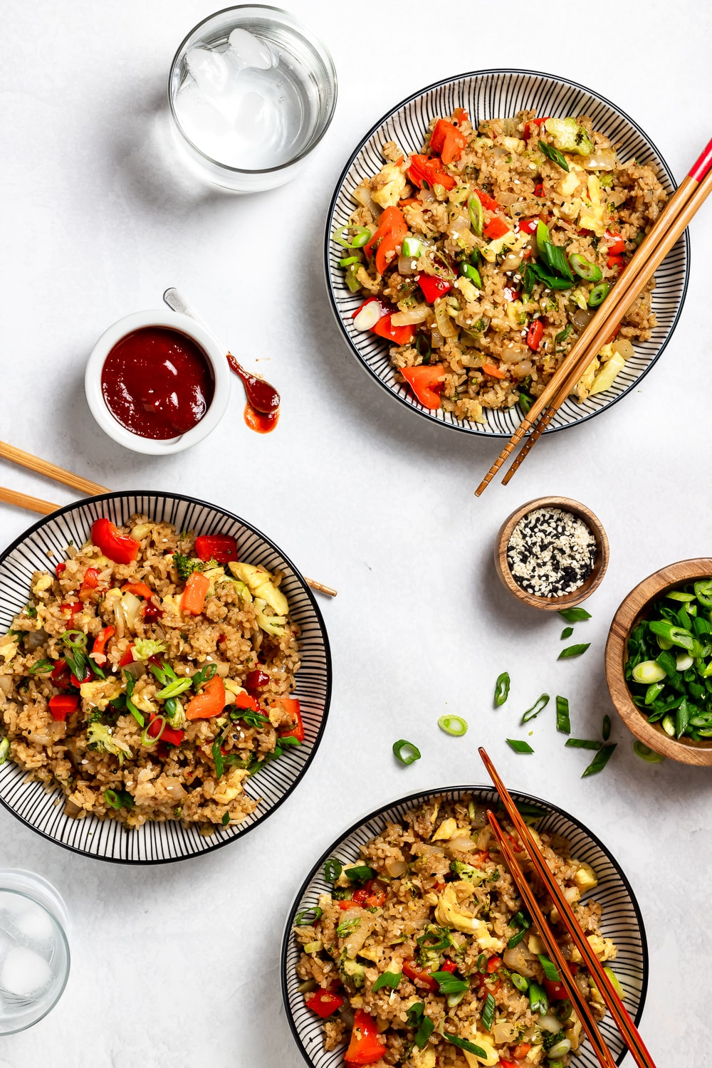 three bowls of fried rice