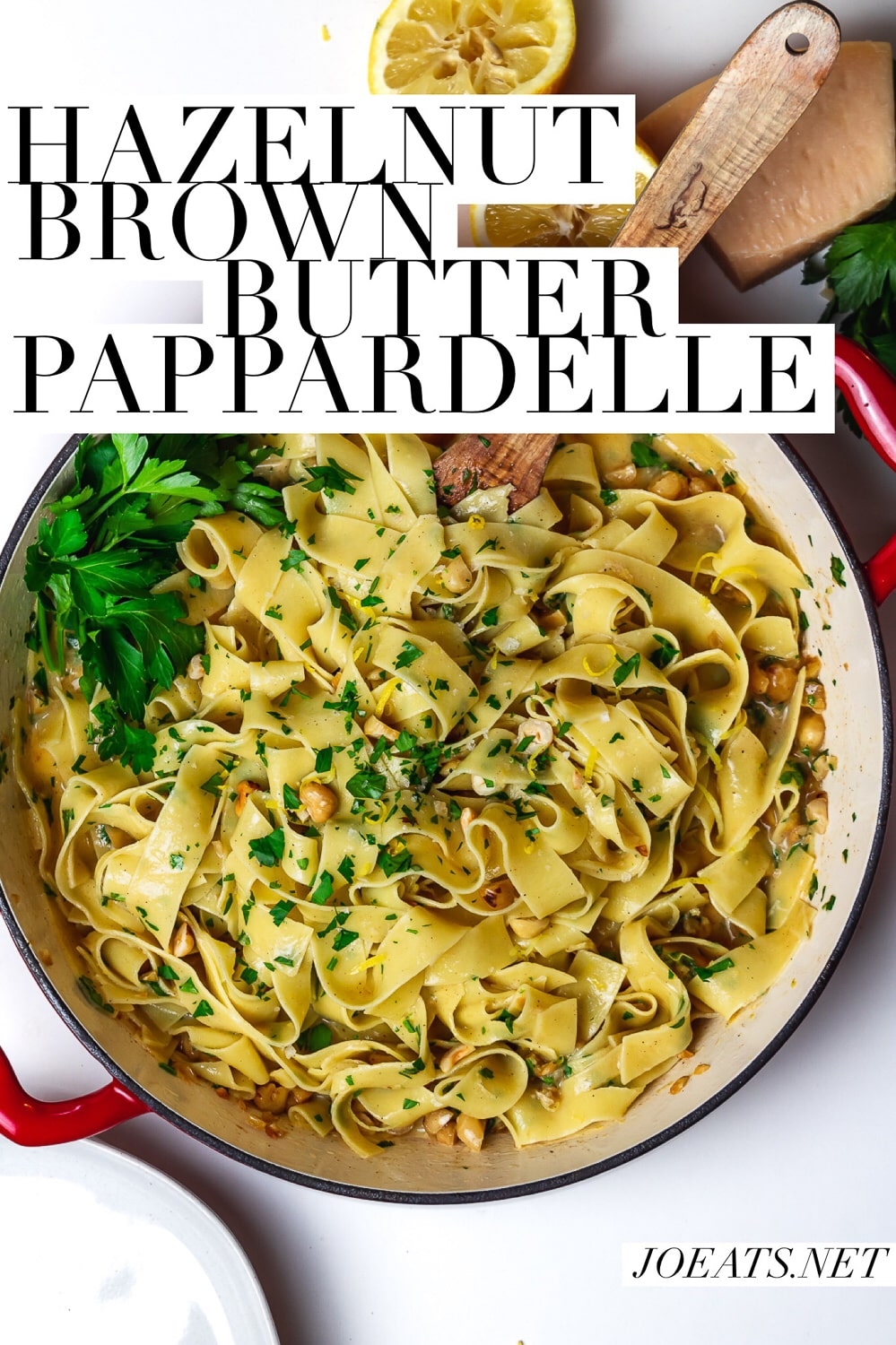 """overhead of large pan of wide noodles with parsley, lemon, parsley, hazelnuts and butter with text overlay that reads """"hazelnut brown butter pappardelle"""" and """"joeats.net"""""""