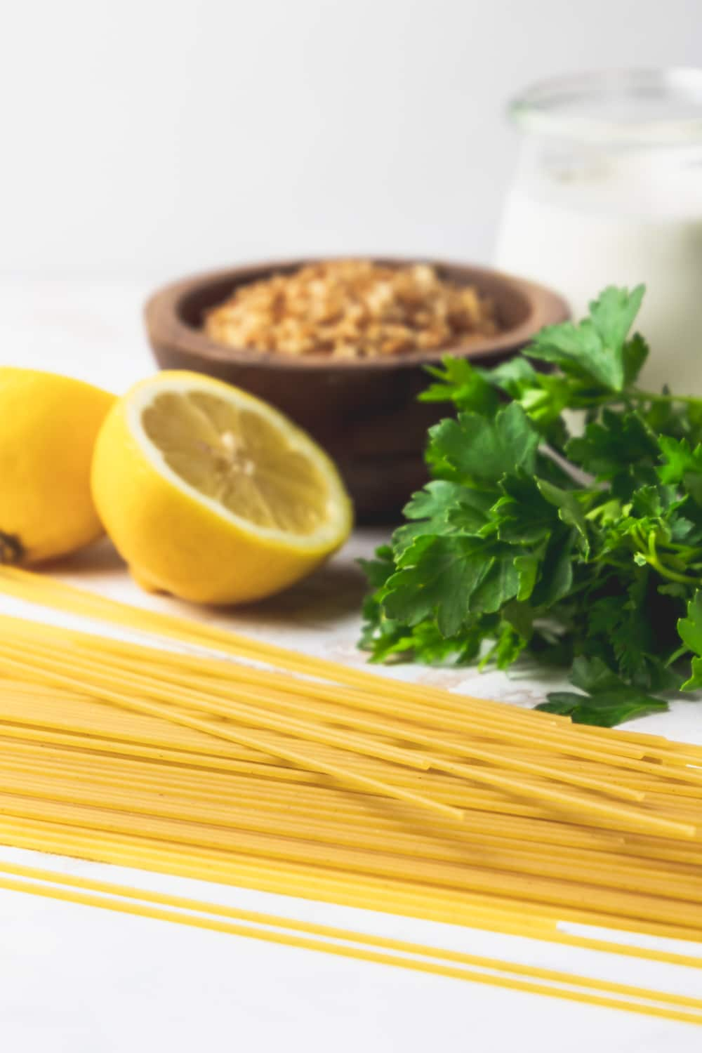 lemons, parsley, heavy cream, dried spaghetti, and crunchy breadcrumbs