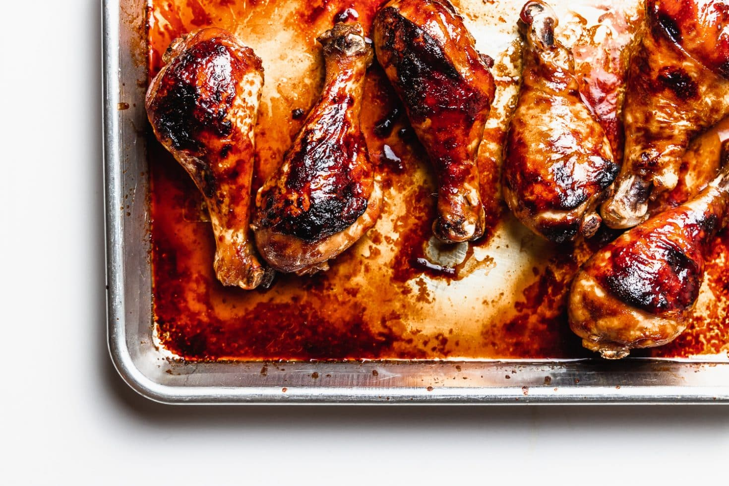 sesame soy chicken drumsticks on a baking sheet