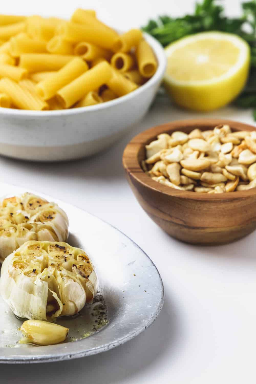 ingredients for creamy vegan roasted garlic rigatoni