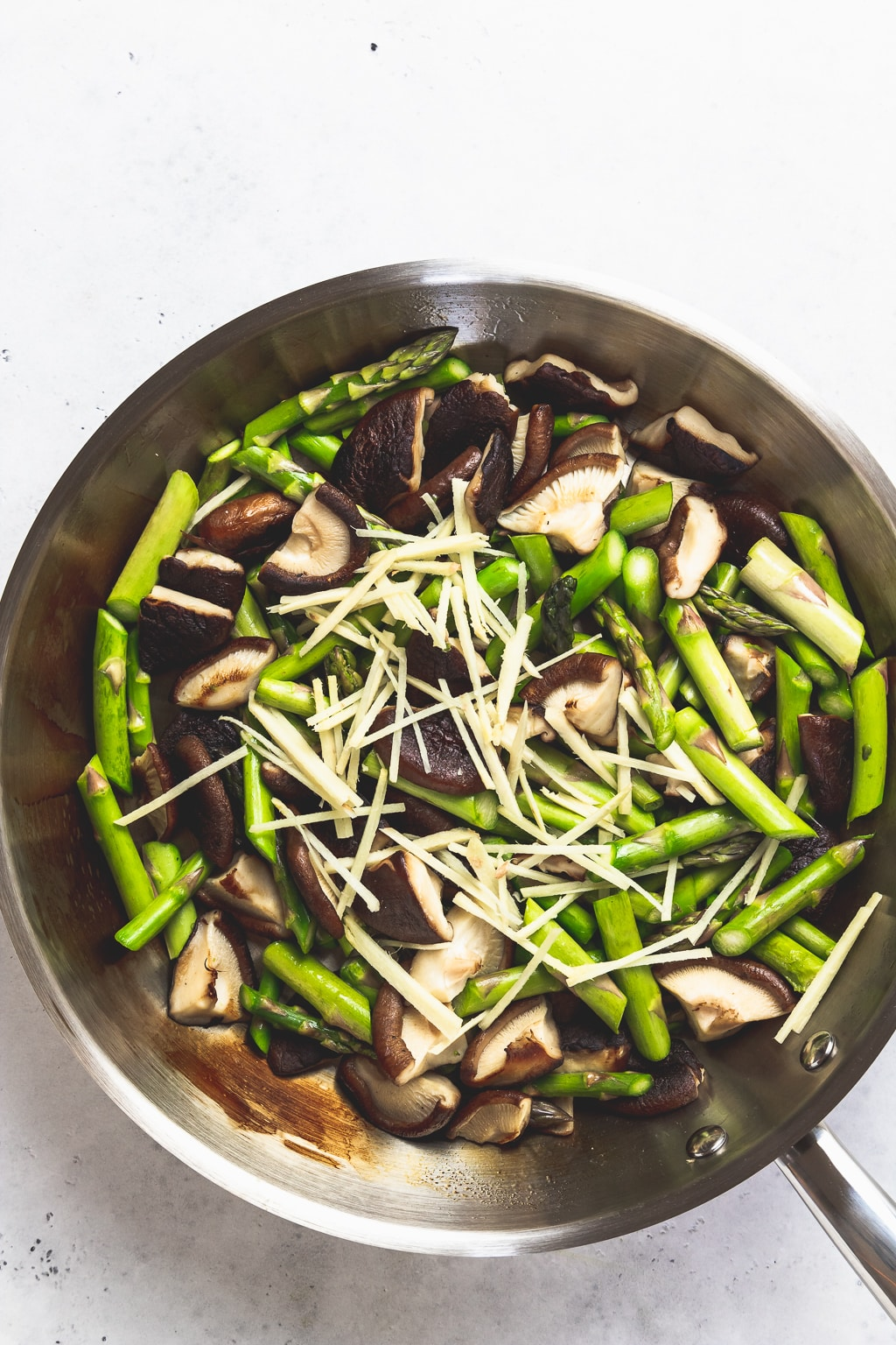skillet with asparagus mushrooms and ginger