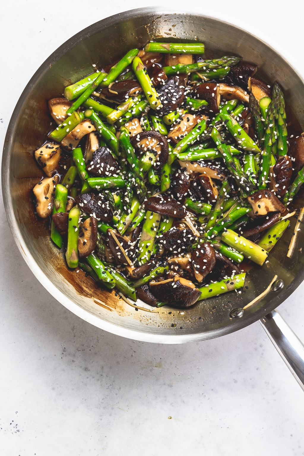 skillet with asparagus and mushroom stir fry