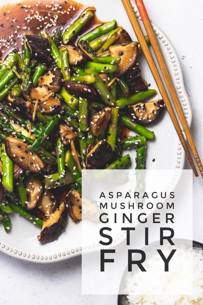 "platter with asparagus mushroom stir fry with chopsticks and text overlay that reads ""asparagus mushroom ginger stir fry"""