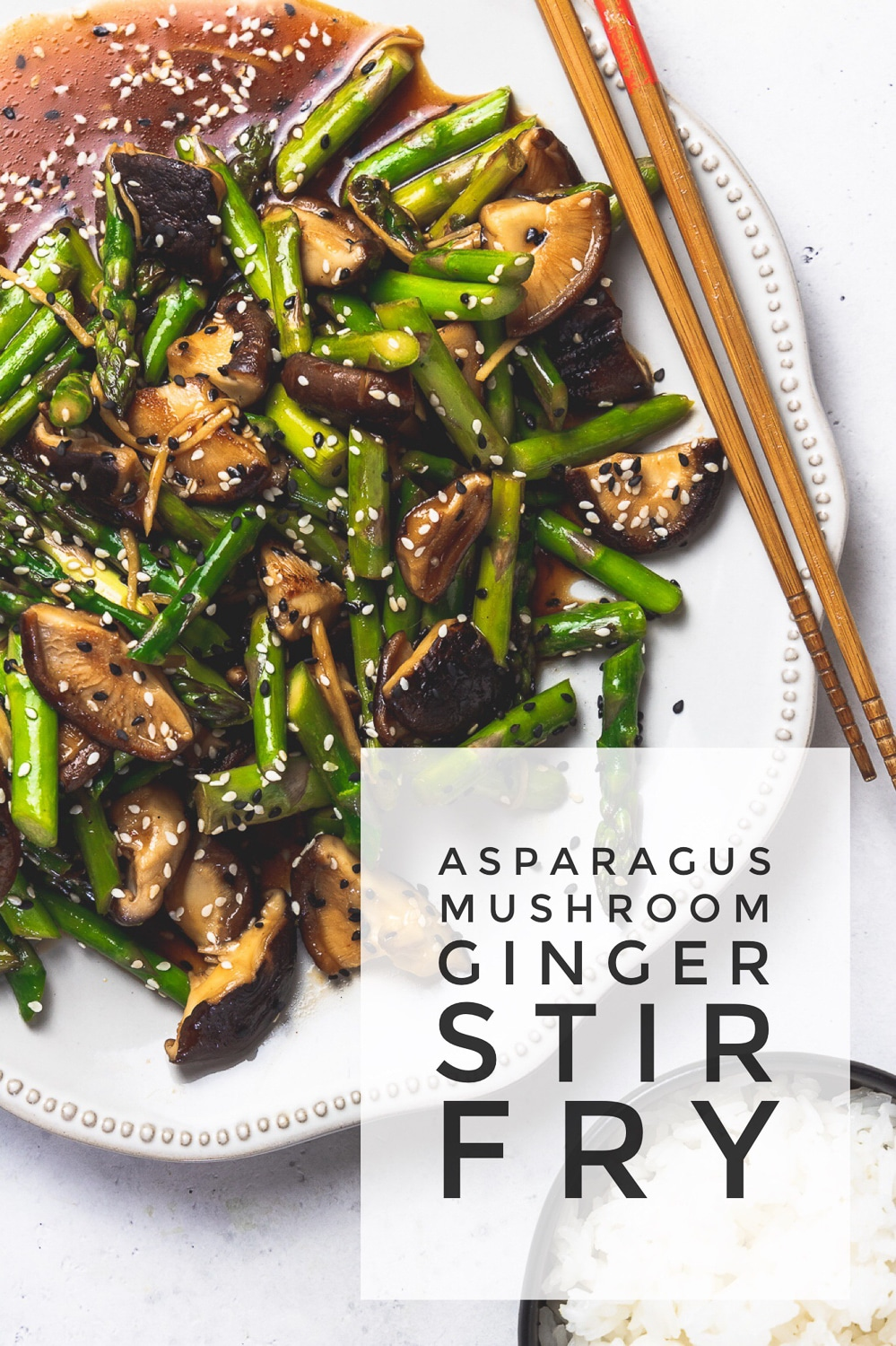 "platter with asparagus mushroom stir fry with chopsticks and text overlay that reads ""asparagus mushroom ginger stir fry"""