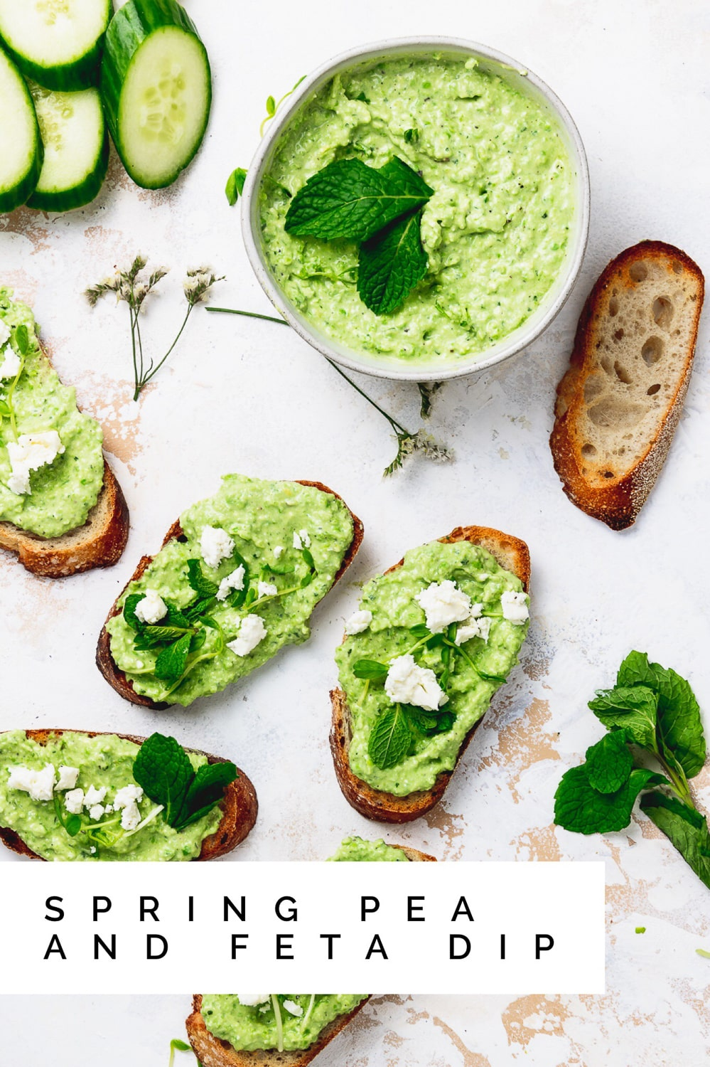 """spring pea and feta dip on crostini with text overlay that reads """"spring pea and feta dip"""""""