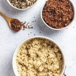 pot with white quinoa, bowls with red and tricolor quinoa, spoon with red quinoa