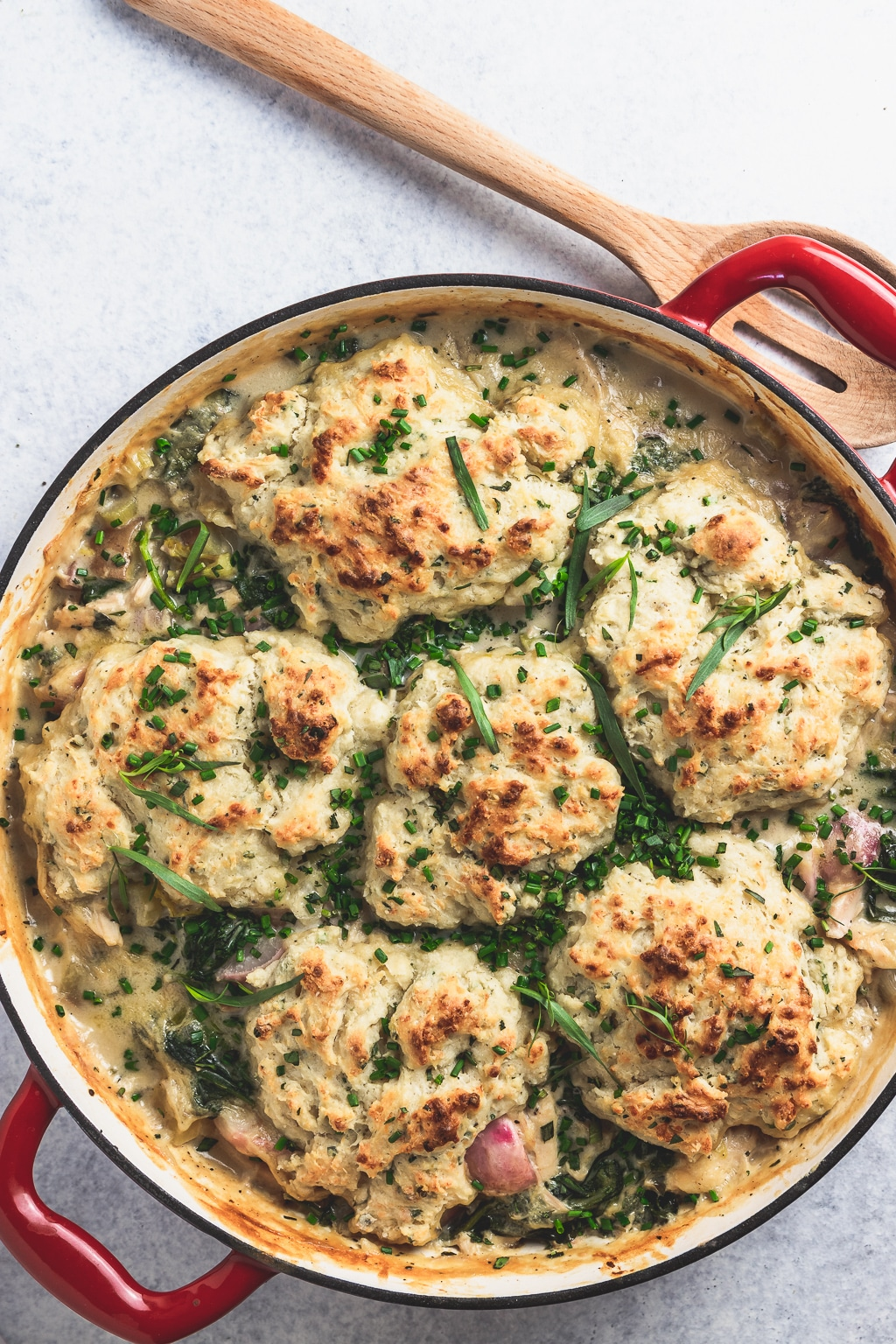 overhead of pan with spring chicken and herbed drop biscuits