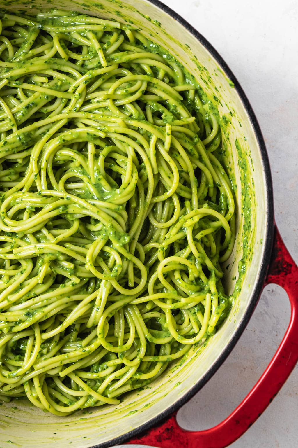 red handled pot with avocado tarragon pesto pasta