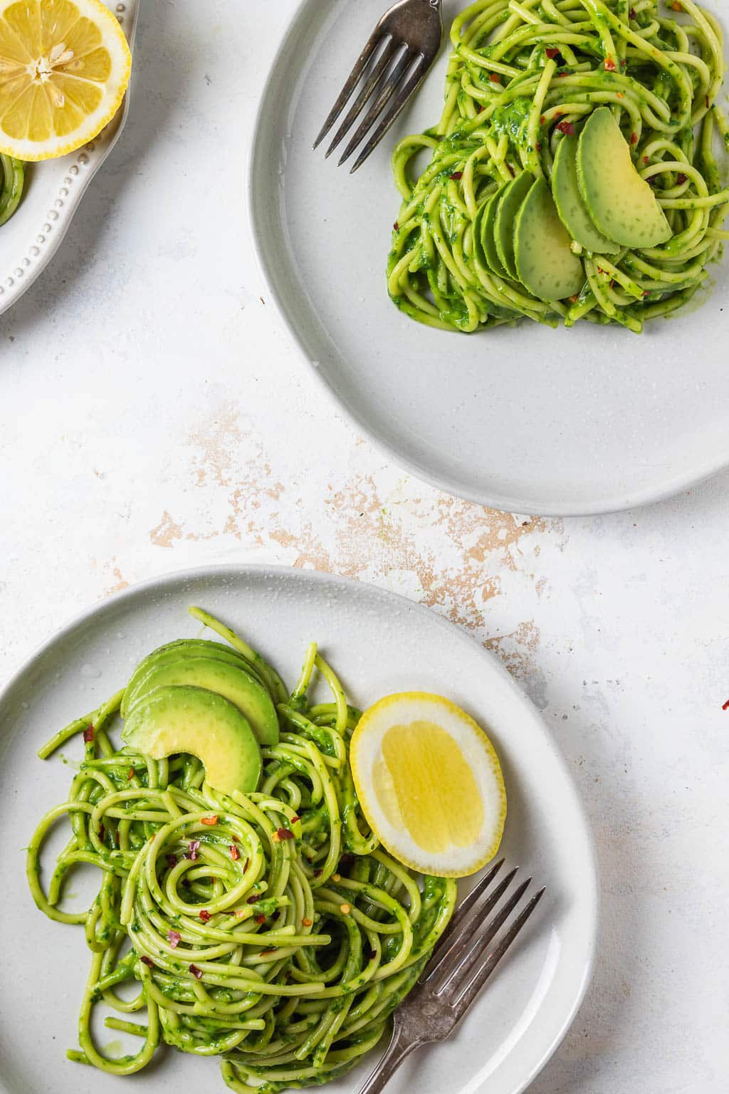 plates of avocado pesto pasta