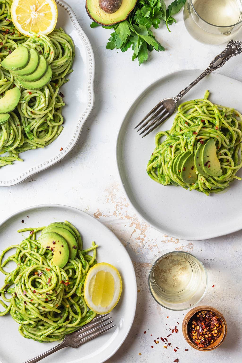plates of avocado pesto pasta