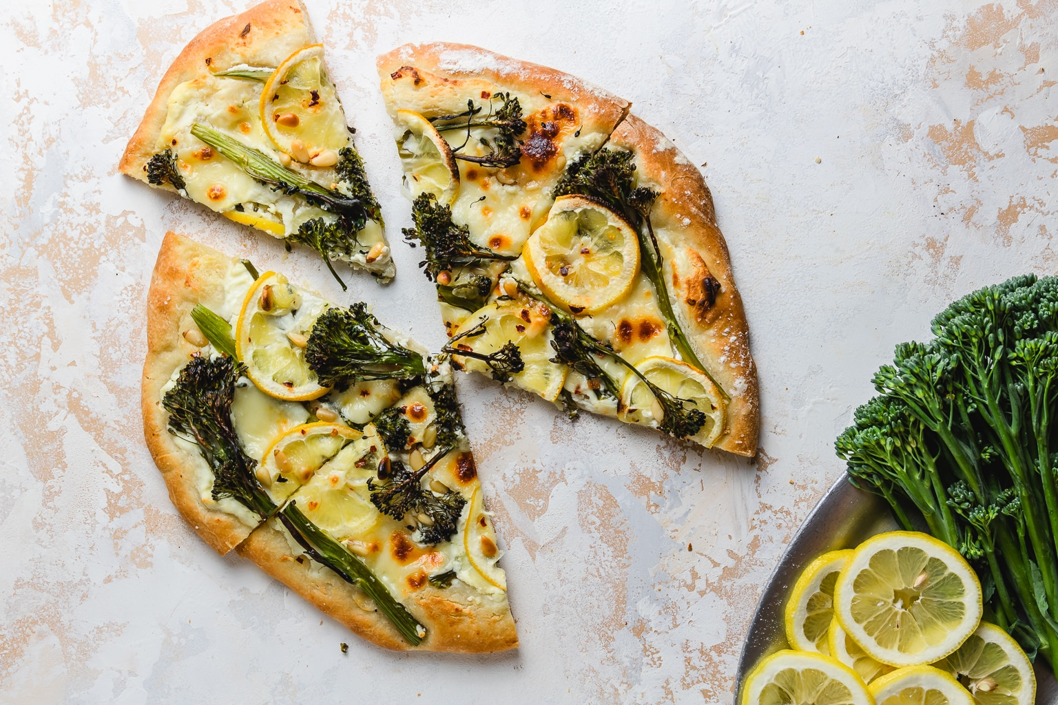 sliced charred broccolini and lemon pizza