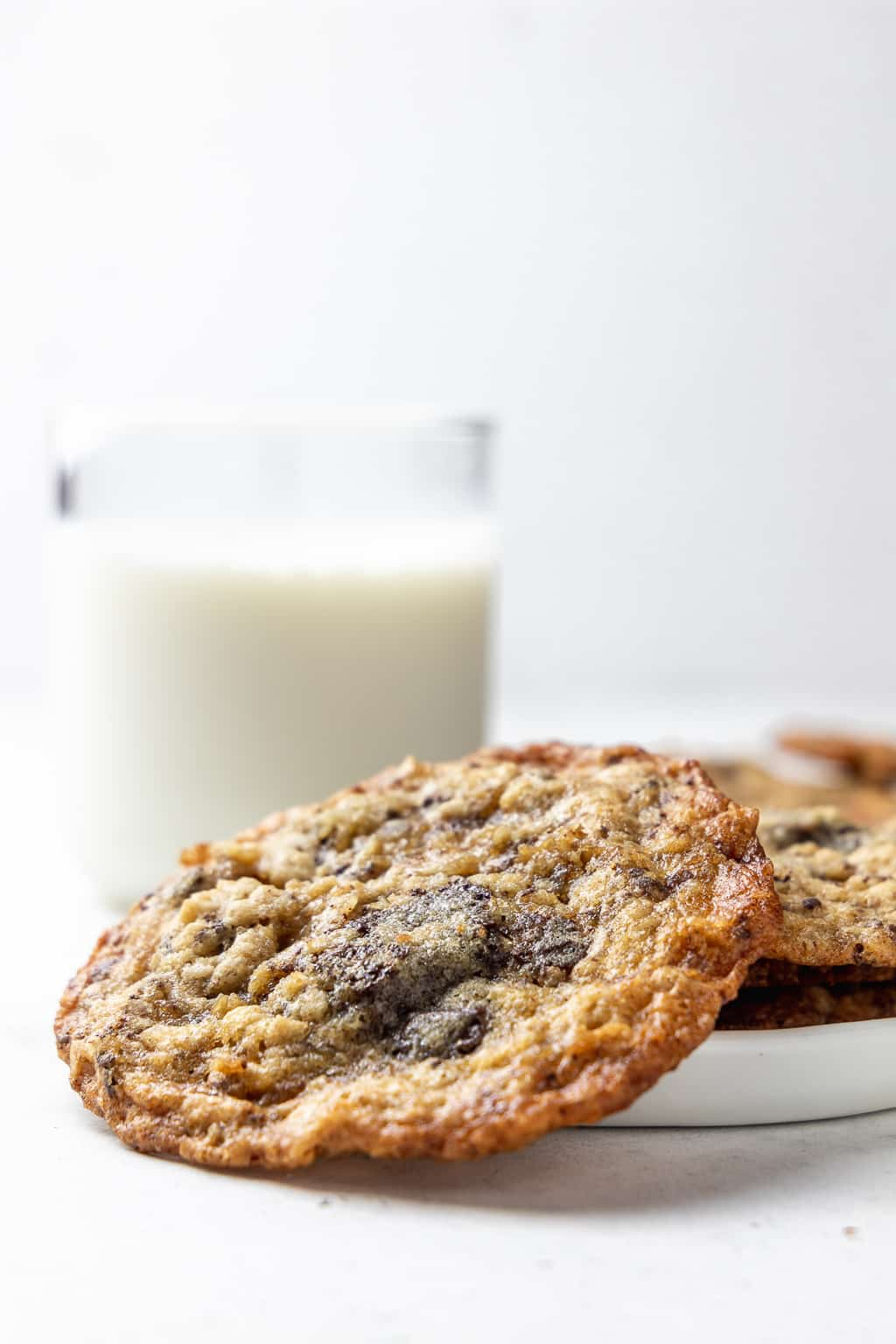oatmeal chocolate chunk cookies with a glass of milk