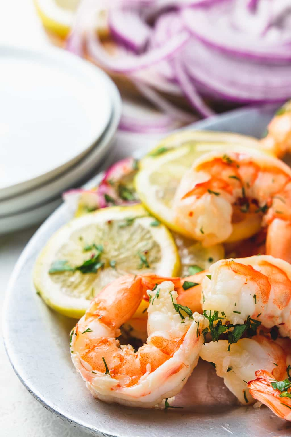 easy pickled shrimp with lemon slices on a silver plate
