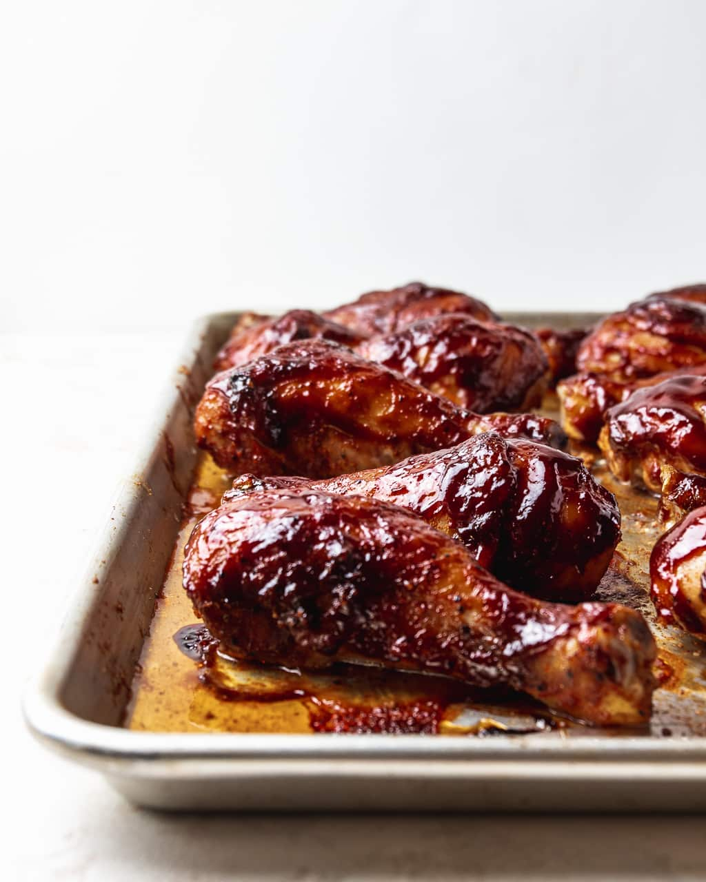 oven roasted barbecue chicken on a sheet pan