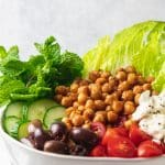 spiced chickpea greek salad in white bowl