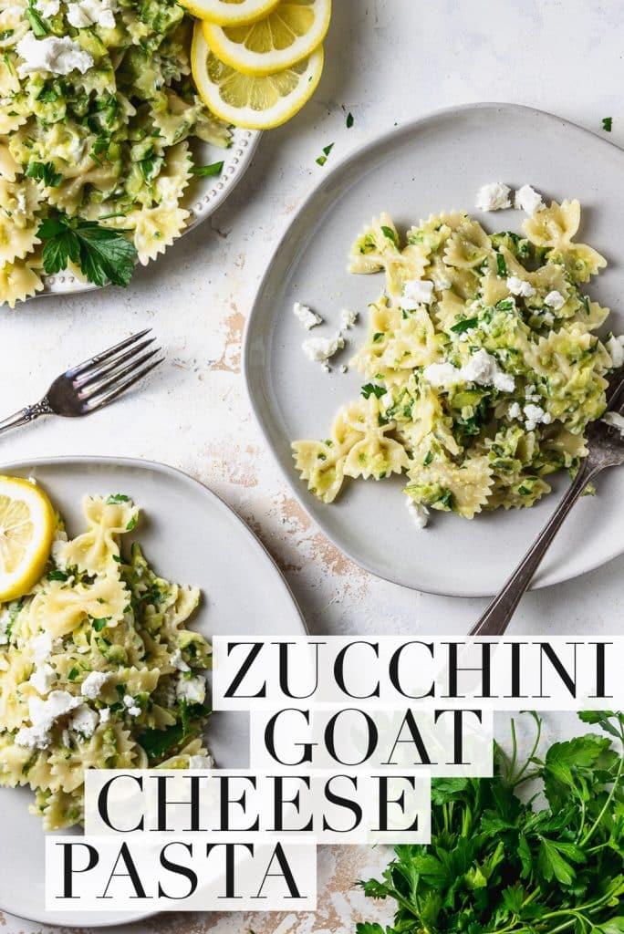 zucchini goat cheese pasta on white plates