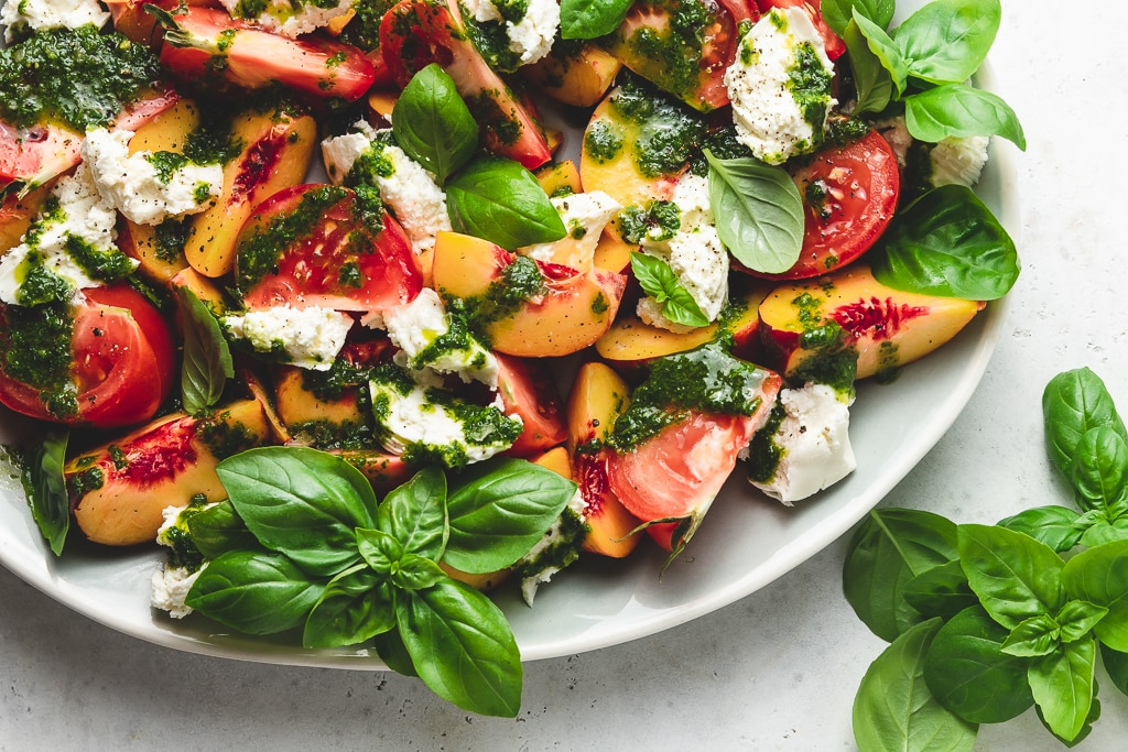 platter of peach caprese salad with basil vinaigrette