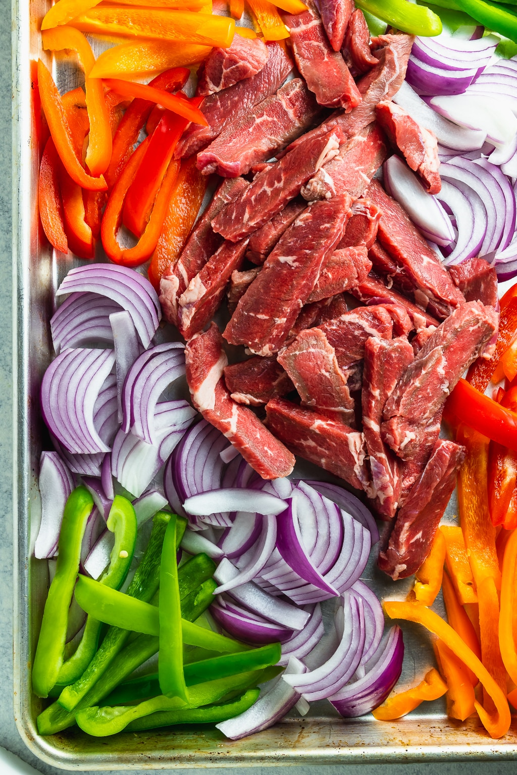 steak and vegetables on a sheet pan