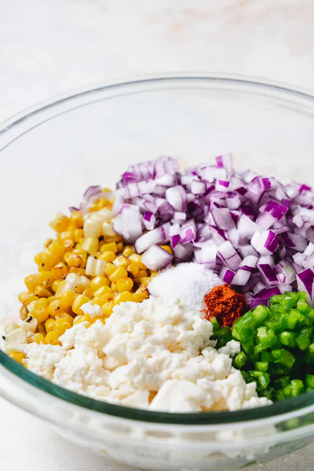 ingredients for spicy street corn dip in glass bowl