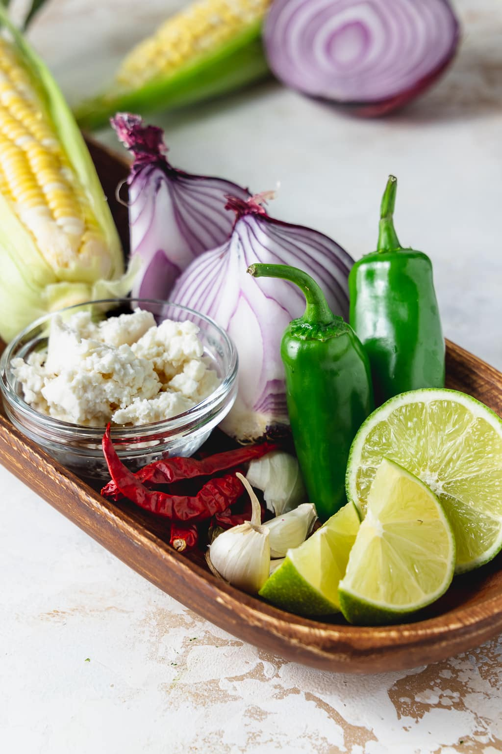 ingredients for spicy corn dip on wooden tray