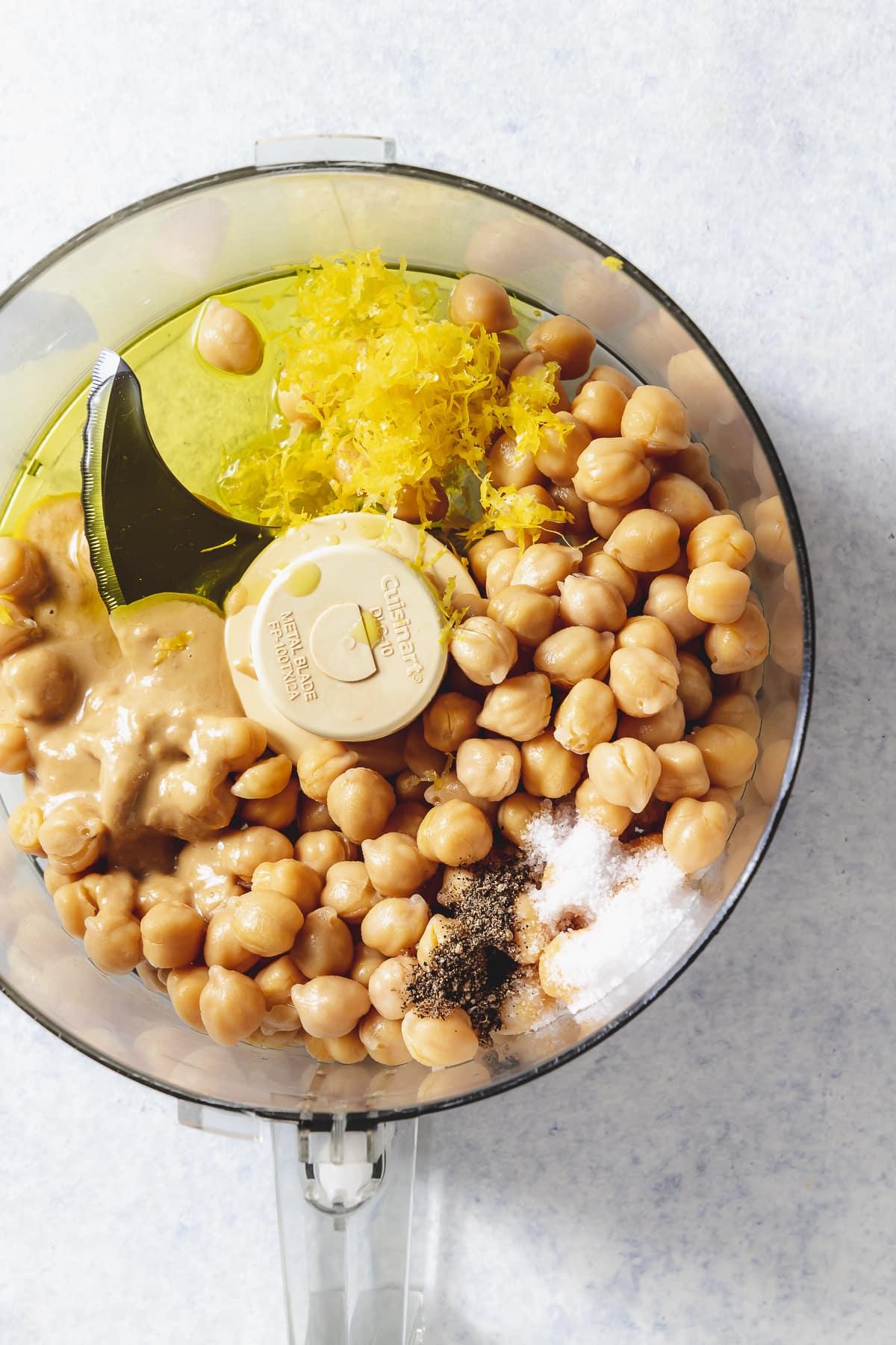 lemon hummus ingredients in a food processor