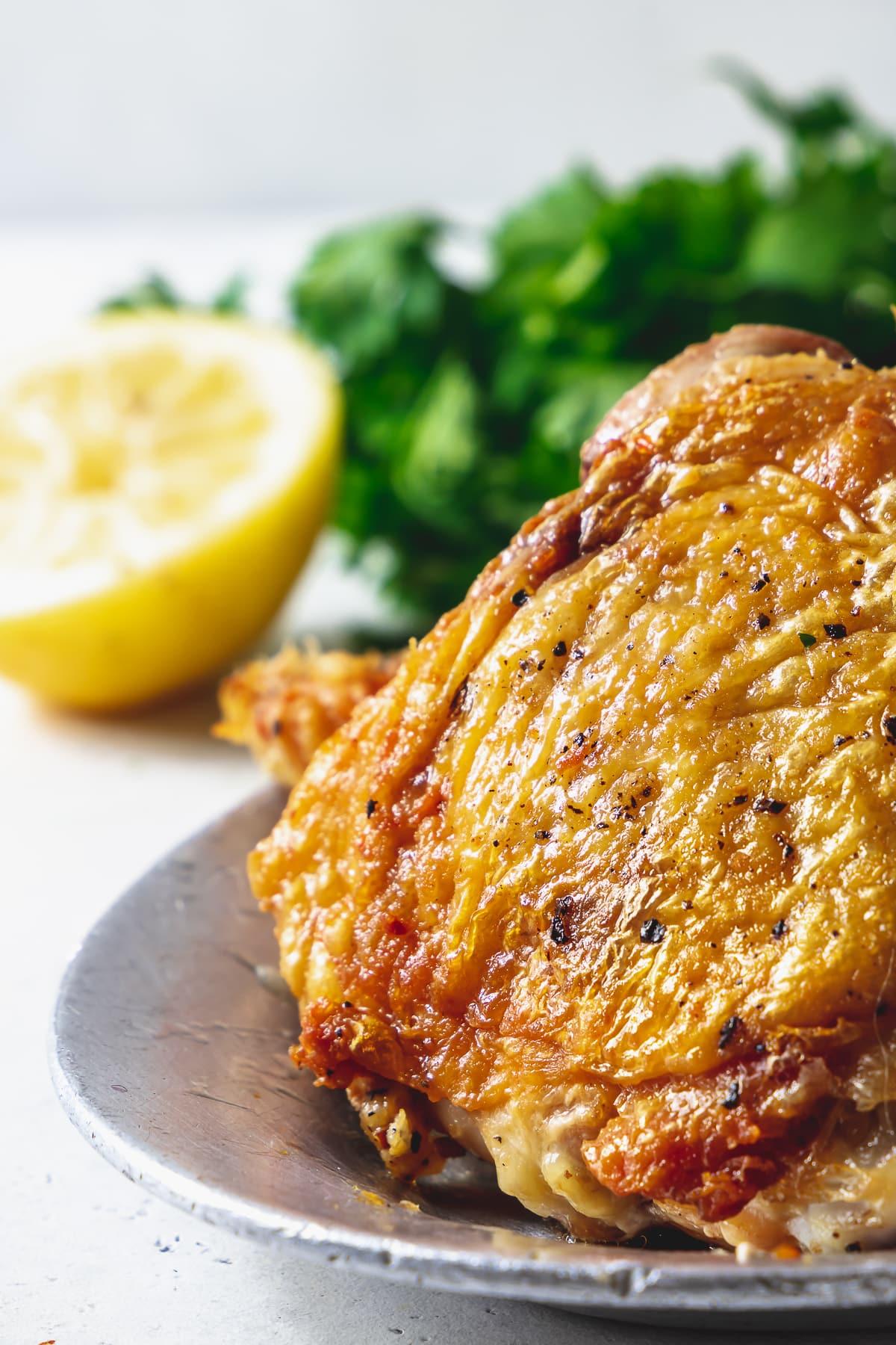 crispy pan fried chicken thigh close up