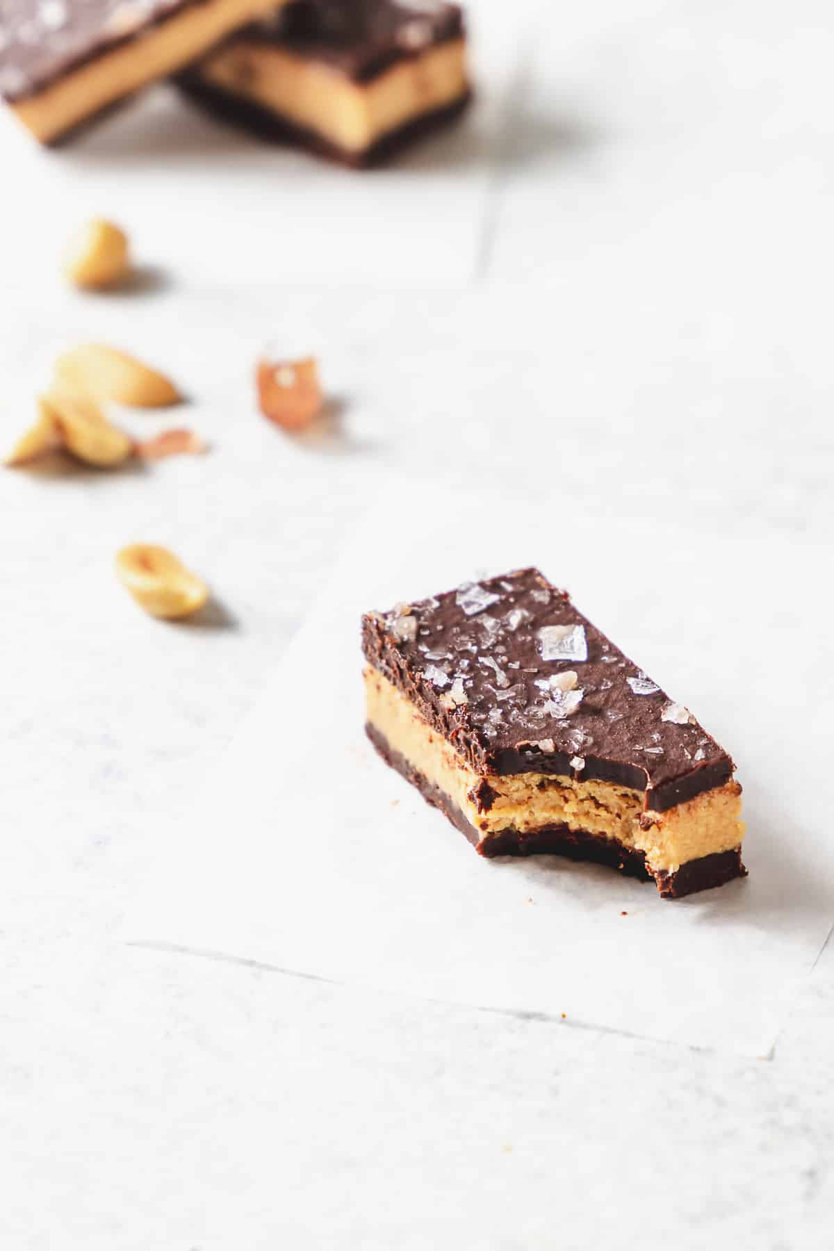 close up of crispy peanut butter candy with bite taken out