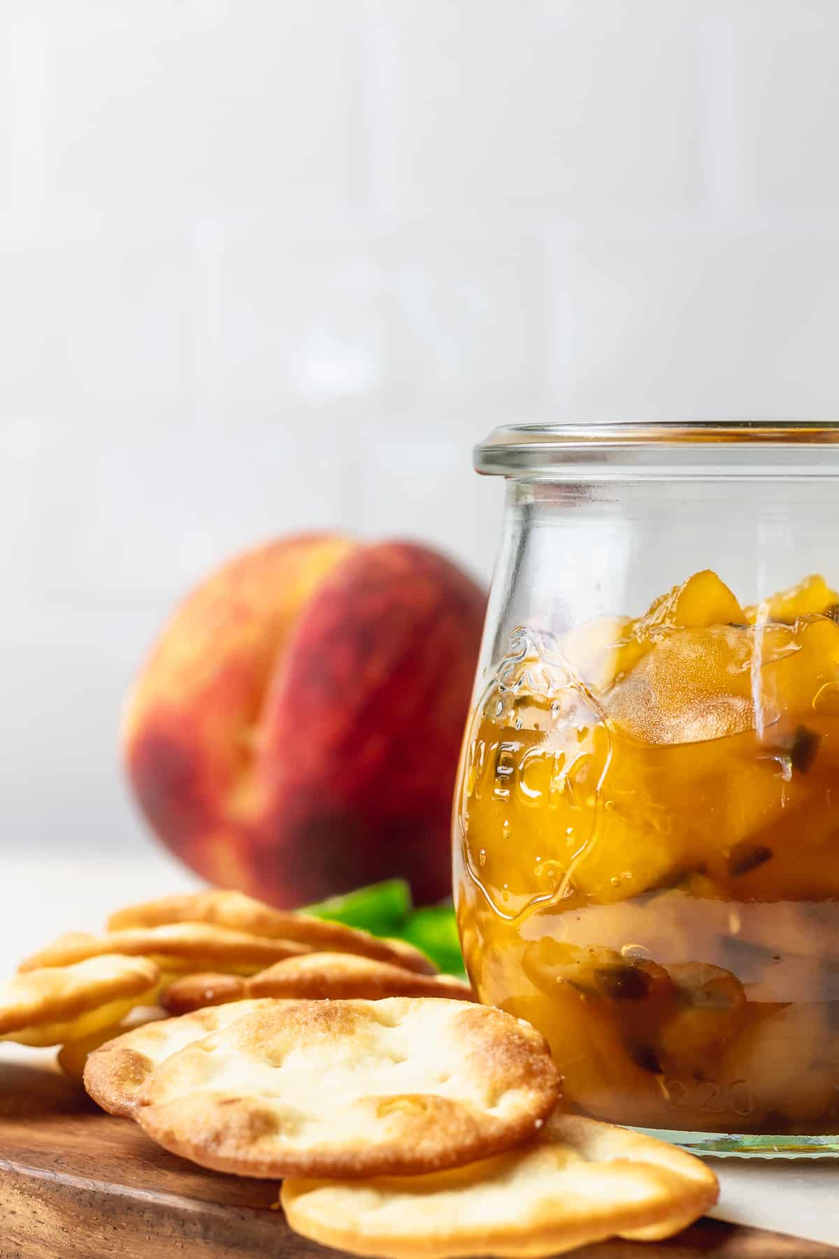crackers and weck jar with peach and jalapeno chutney