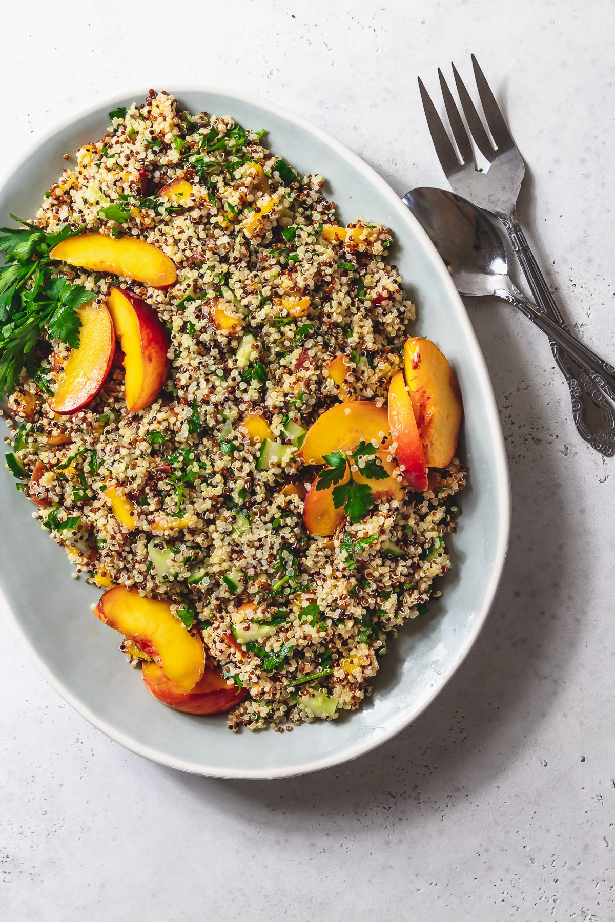 peach quinoa tabbouleh on a platter