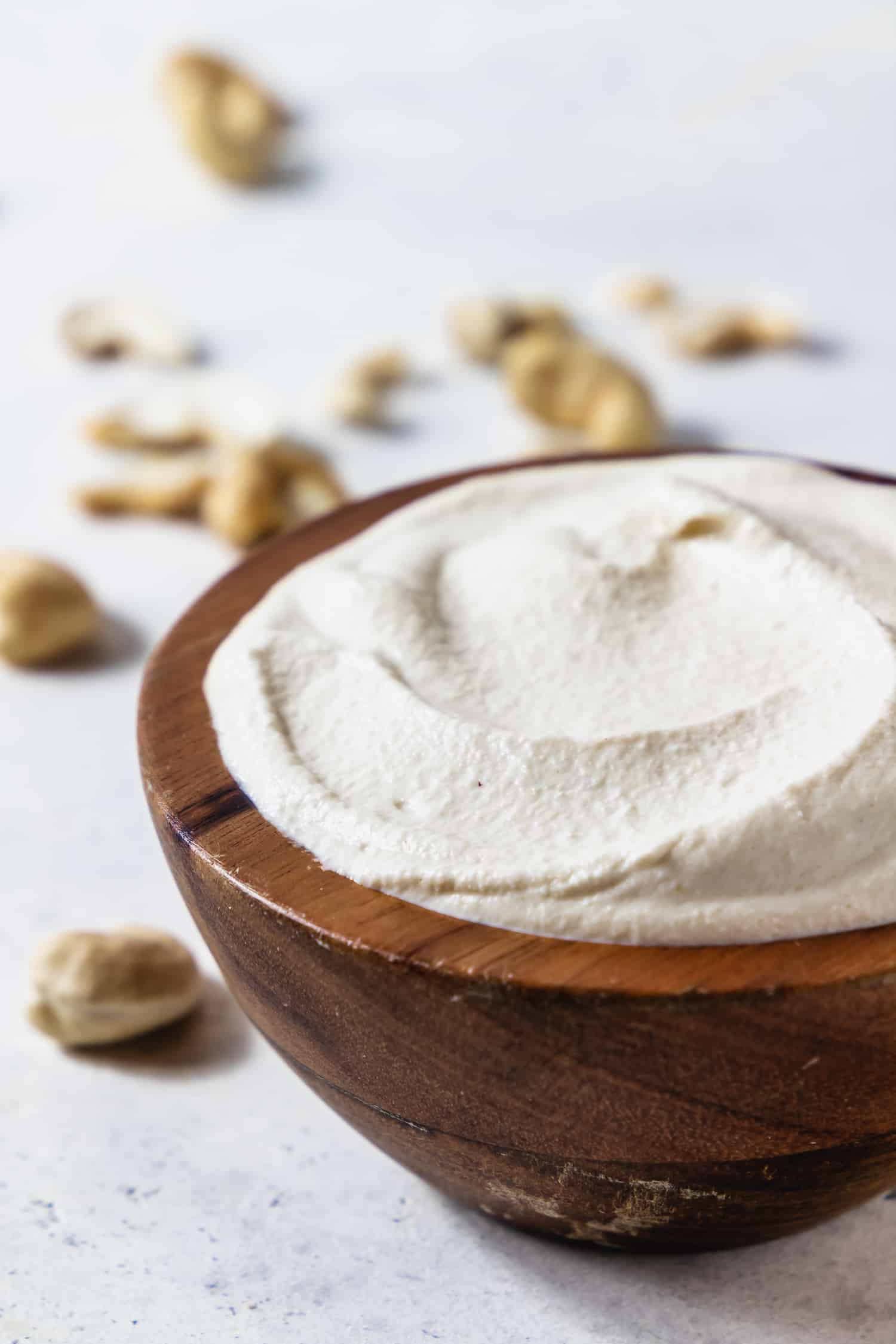 cashew cream in a wooden bowl