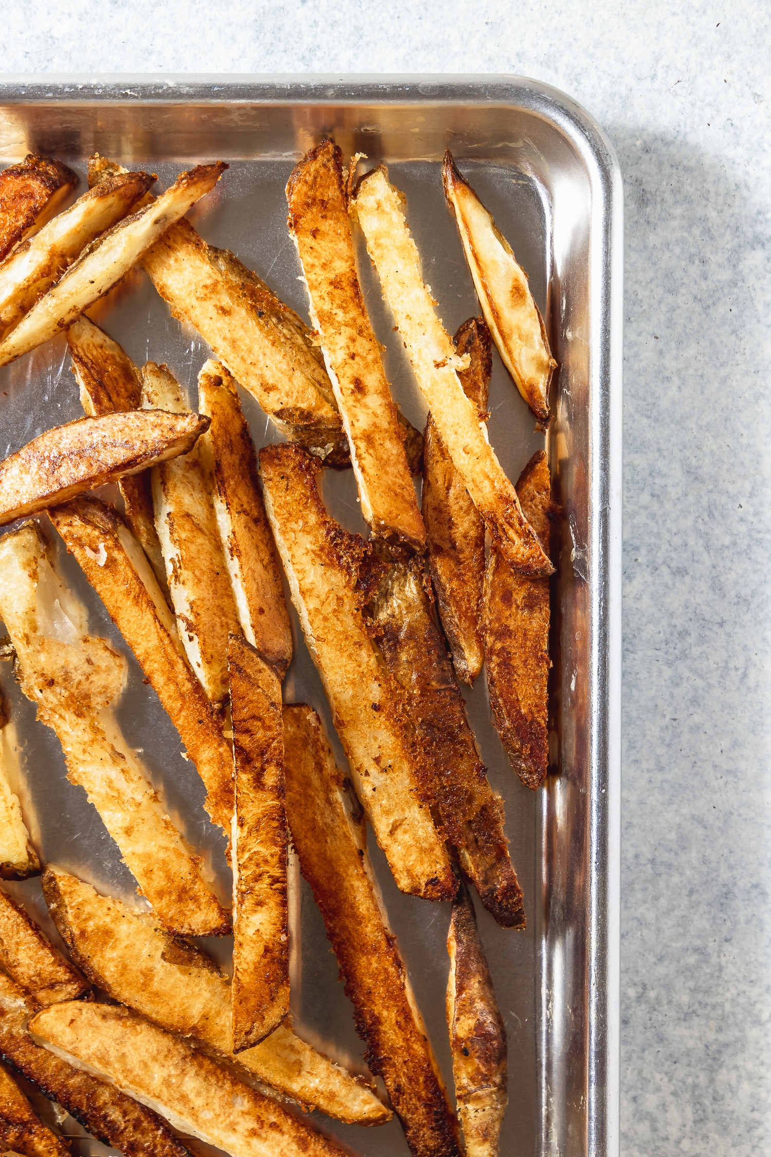 crispy oven fries on a sheet pan