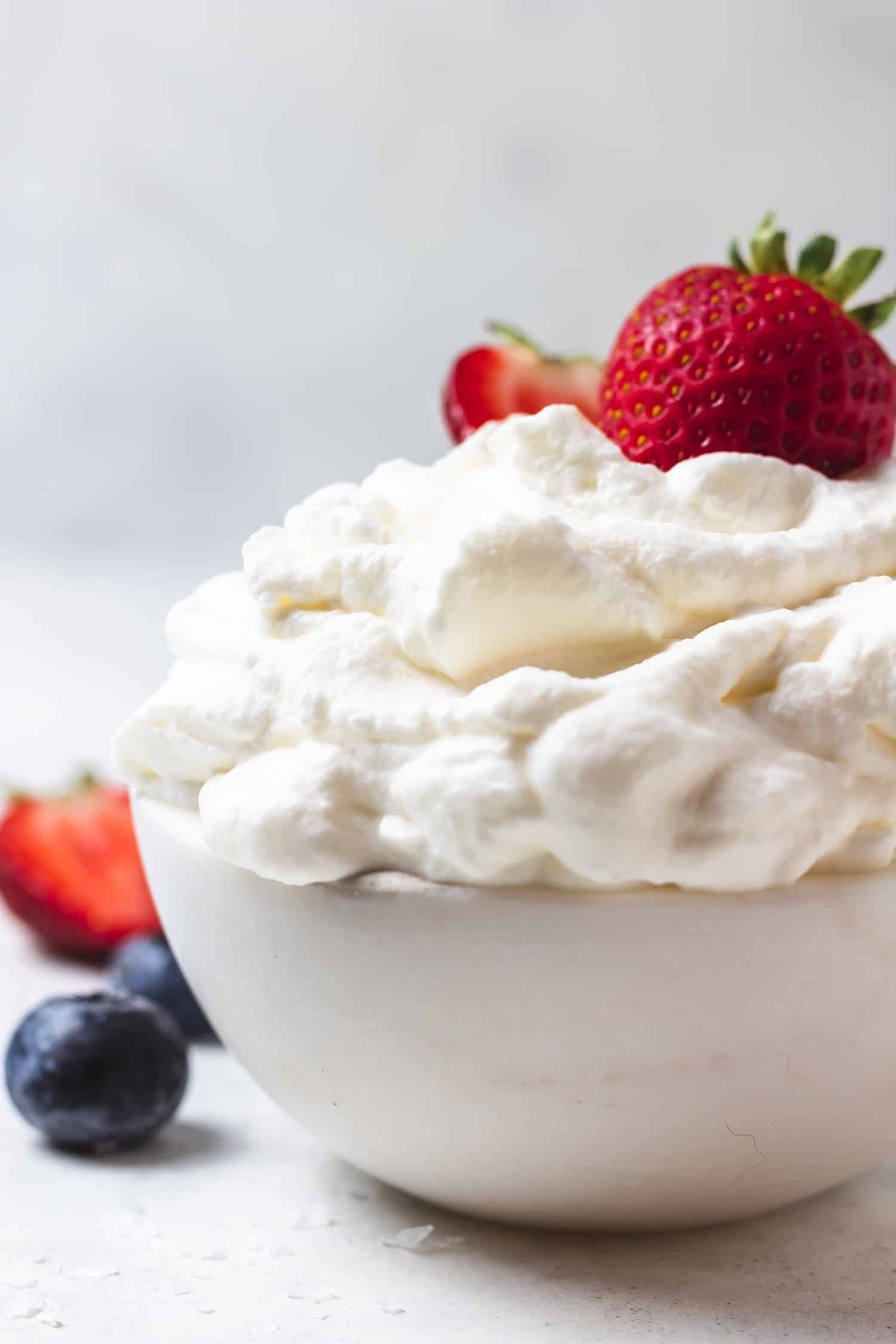 bowl of salted honey whipped cream with berries