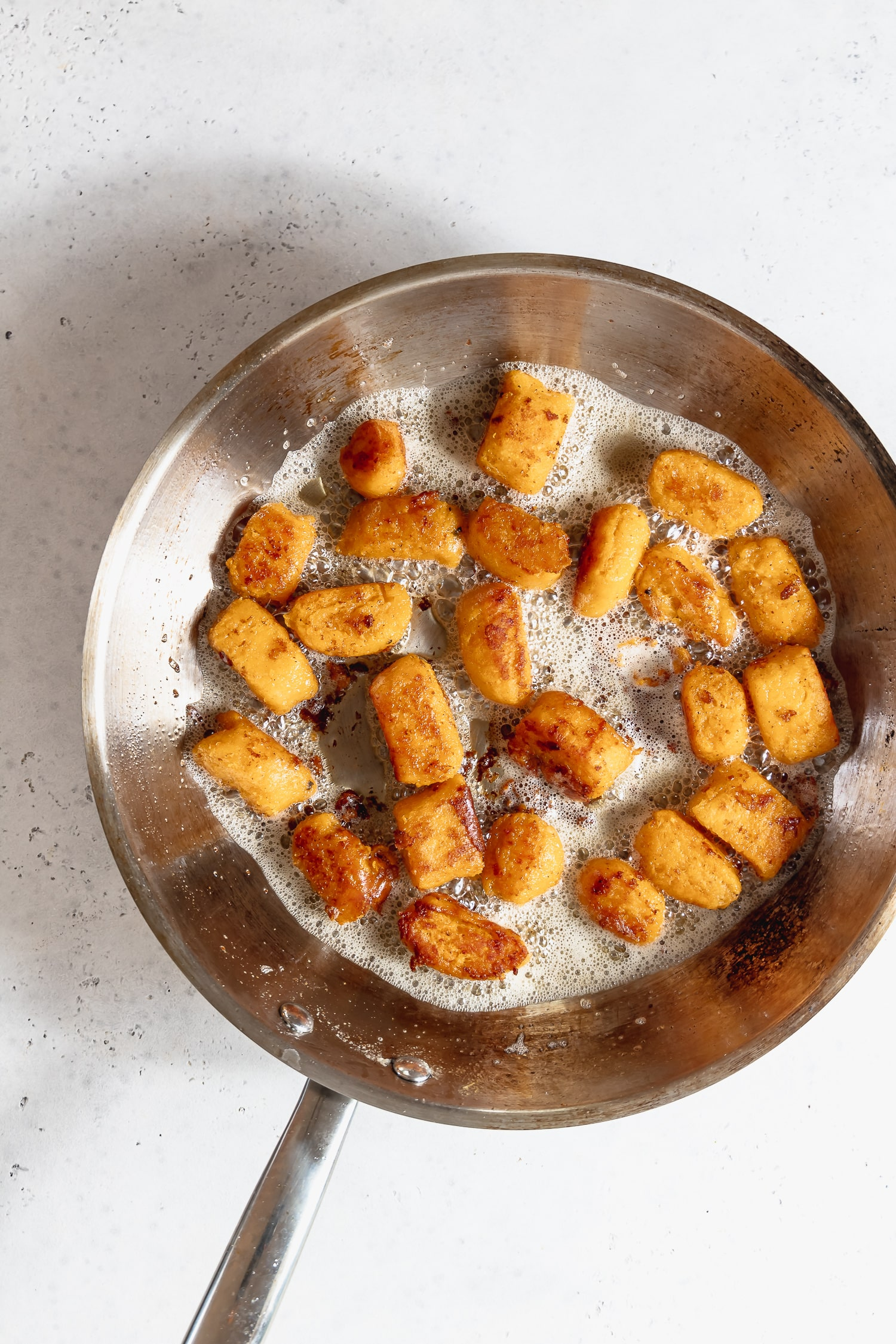 skillet of sweet potato gnocchi in brown butter