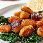 plate of sweet potato gnocchi with kale and brown butter