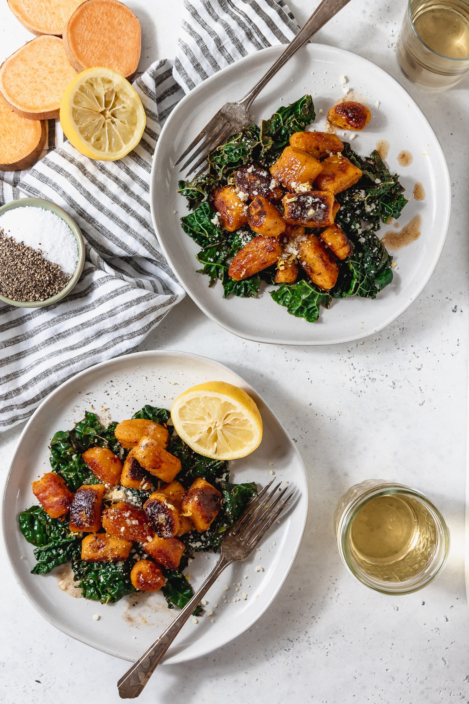 two plates of sweet potato gnocchi with kale and brown butter