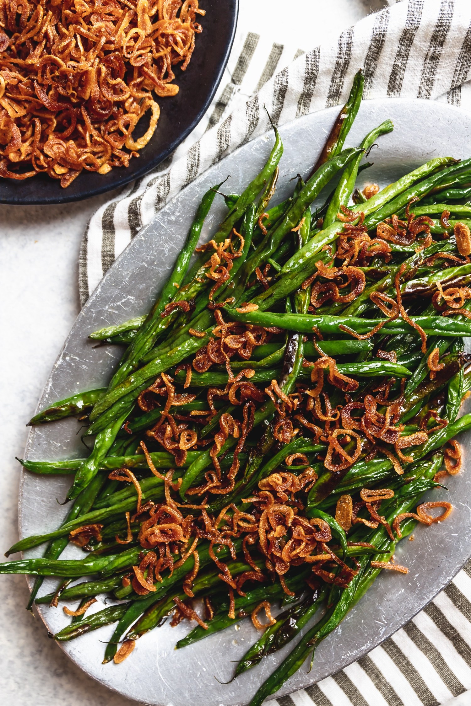 charred green beans and crispy fried shallots